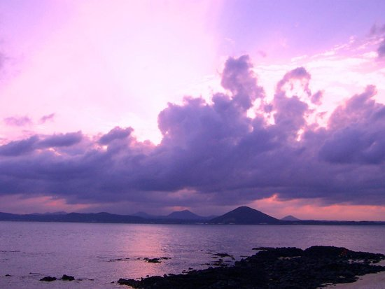 Sunset view from Udo's white coral beach, looking toward Jeju