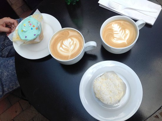Baked and Wired: Cupcakes and latte - life is good (coconut cupcake on the bottom right is great).