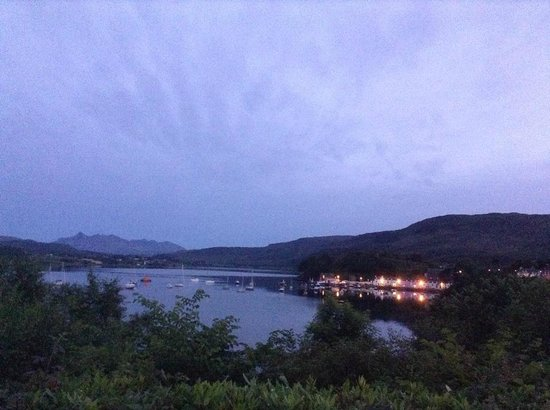 Cuillin Hills Hotel : Portree from the garden at night with the Cuillins in the distance.