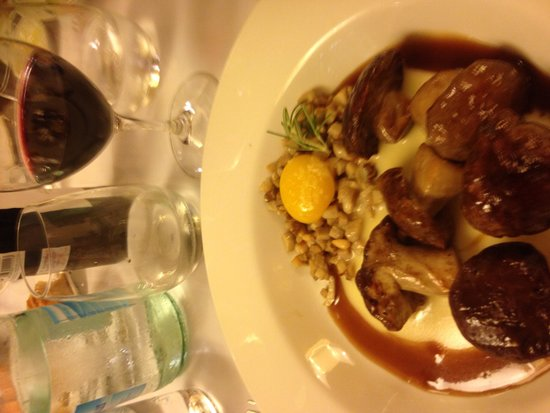 Casa Urola: Charcoal wild  mushroom Caps with pine nuts, duck jus and egg yolk for starter