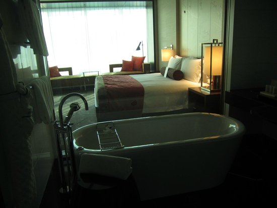 Conrad Tokyo: You can see the bedroom from the bathroom, but don't worry you can close the automated blinds!