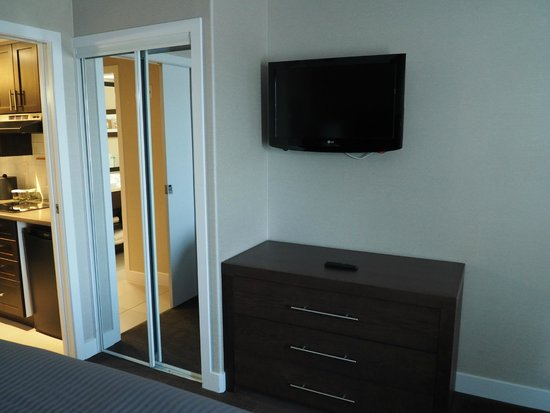 Sandman Signature Prince George Hotel: Bedroom has a small closet, drawers, and a 32