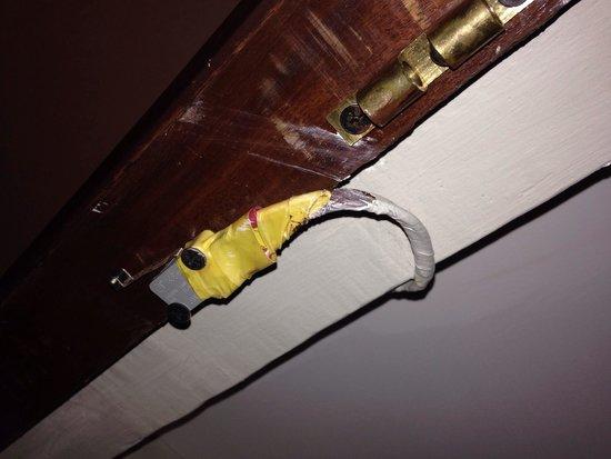 Palm Garden Beach Resort & Spa: Ooh ! Fire hazard ! Wardrobe wire taping