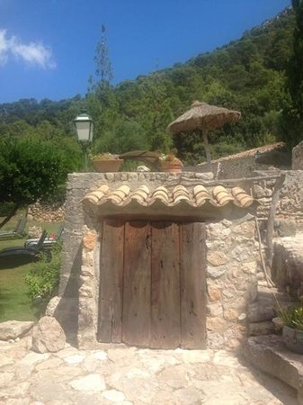 Finca Es Castell: pool hobbit house, just an example of how to make the pool filter and pump room look quaint
