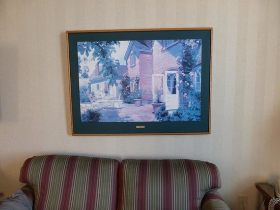 """Hotel Winneshiek: Questionable """"art"""", faded, inappropriate for the room, poorly hung"""