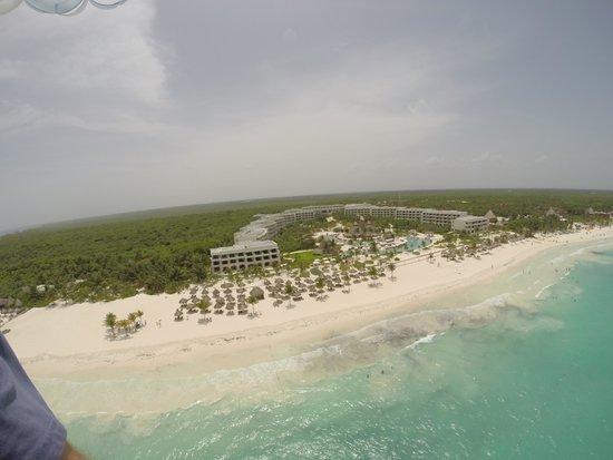 Secrets Maroma Beach Riviera Cancun: Parasailing looking down at the resort