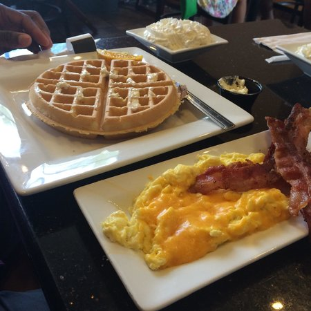 Keke's Breakfast Cafe: Waffle (whipped cream on the side) with eggs (cheddar cheese) and bacon.