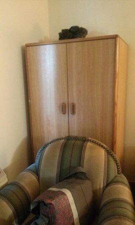 Grand Rapids Inn: big chair blocking armoire