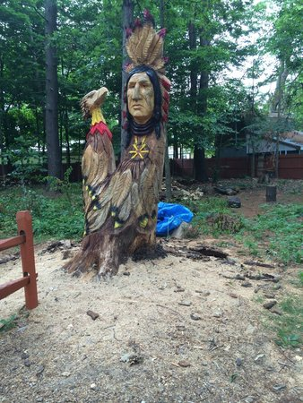 The Elms Waterfront Cottages: Carved Indian Next to Our Cottage
