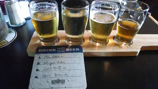 The Reservoir - Restaurant and Tap Room: Flight! Got a souvenir coasterwith the names of the beers on them.