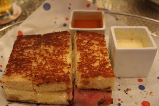 Le Burger Brasserie: Part of my delicious grilled ham and cheese