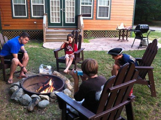 Boston/Cape Cod KOA: Outdoor campfire beside the cabin