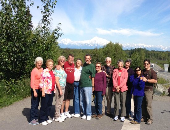 Alaskan Tour Guides Day Tours: Tour group with a spectacular view of Mt. McKinley in the background.