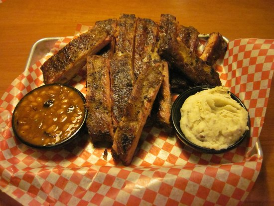 Famous Dave's: Full Slab of Ribs, MAsh and Wilbur Beans.