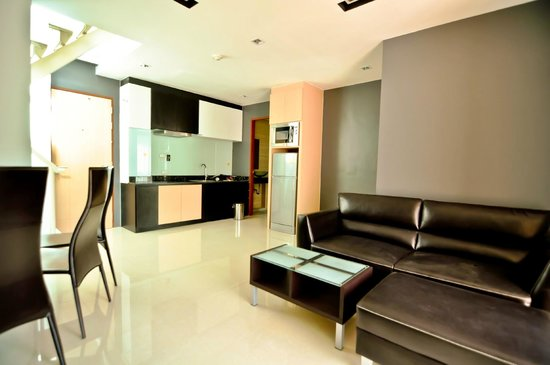 Royal Kamala Phuket Condominium : Living area and kitchen in Penthouse 1-bedroom