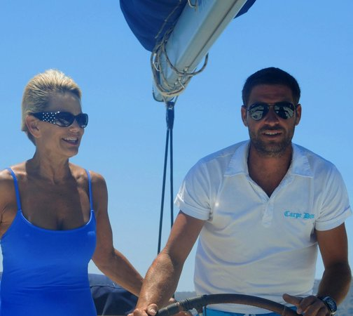 Santorini Sailing Center: Getting some steering tips from the Captain!