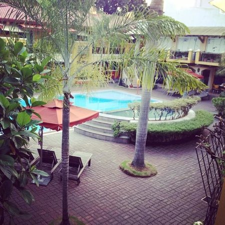 Crown Regency Residences Davao : The view of the pool from the small balcony of Room 127
