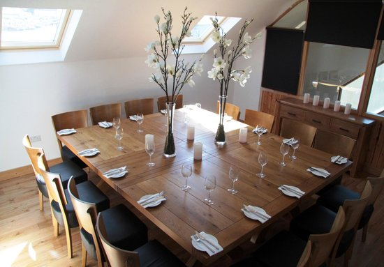 the chart room - upstairs private dining room can sit up to 20 20 Person Dining Table