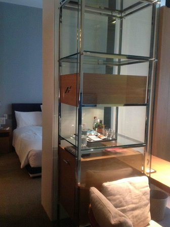 Andaz 5th Avenue: A bedroom is separated from the working area, minibar.