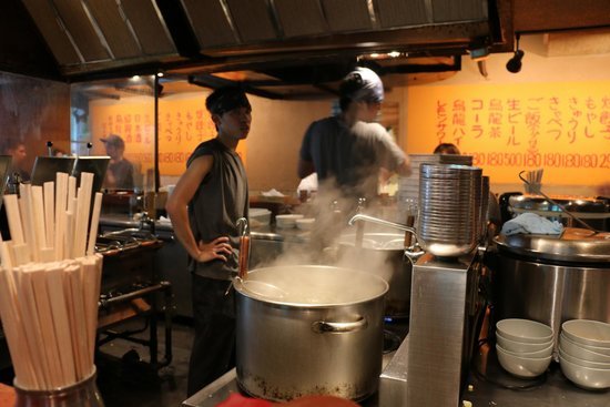 Harajuku Gyozaro: Your view of the kitchen from the counter seats.