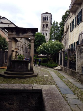 San Giulio Island: The tower of Basilica S. Giulio from the path of Silence