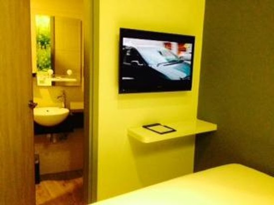 J8 Hotel: The bathroom and TV - taken from the bed