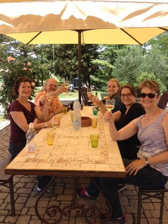 Fun in Tuscany: enjoying white wine after our ride