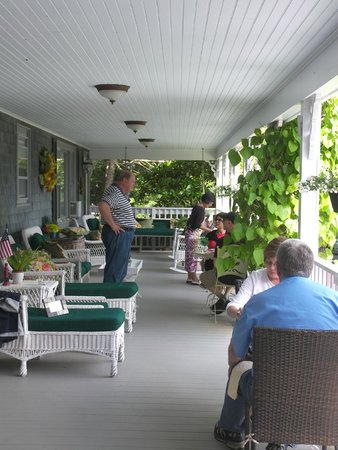 Inn at Bay Ledge: Jack chatting with guests at breakfast on the porch