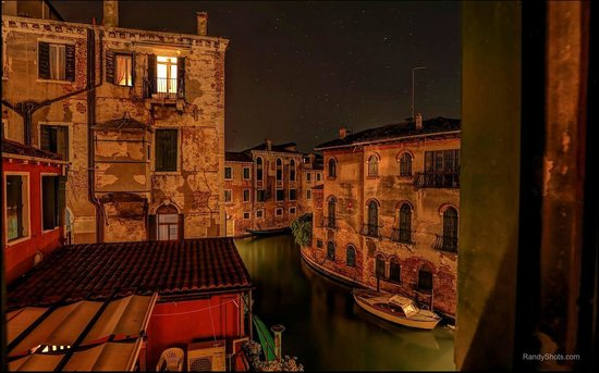 Hotel Dalla Mora : looking out the window at night from our room.