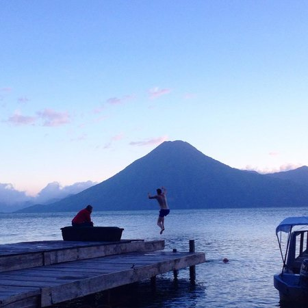 Laguna Lodge Eco-Resort & Nature Reserve: My boyfriend jumping in the turquoise water at sunset