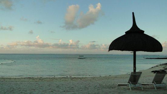 Ambre Resort & Spa: Relaxing on the beach under the thatch umbrella