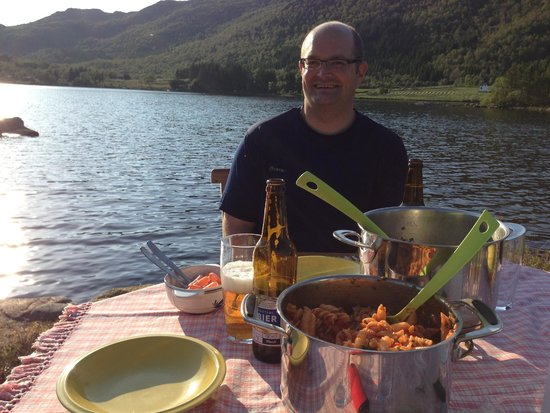 Anne Gerd's Lofoten: My husband and our dinner down by the lake behind the guesthouse