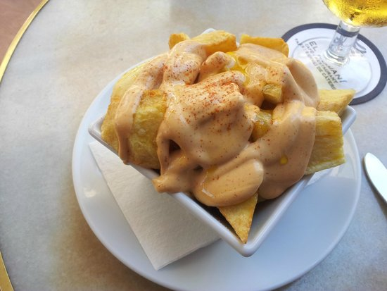 "El Romani: ""Patatas bravas"", fried potatoes with spicy sauce"