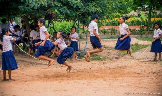 Khmer Ways - Moto Adventures Day Tours: school kids taking a break