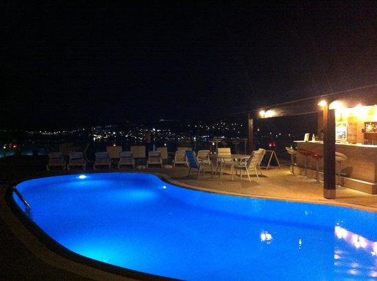 Sestra Apartments: Pool area and views at night