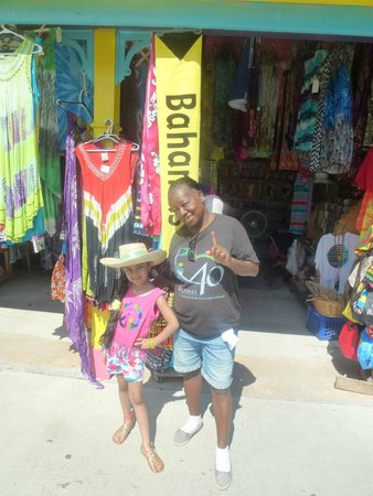 The Bahamas' Arts and Straw Market : Our daughter Bella with one of teh vendors that made a straw bag for her.