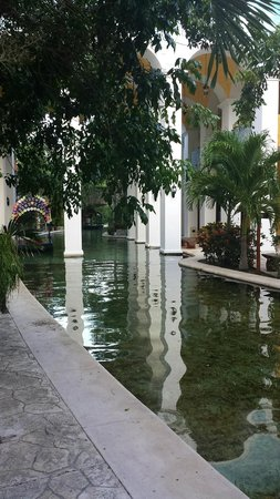 Occidental at  Xcaret Destination: Canals that run through on site $$$ shopping area