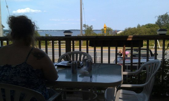 Mo's Grill & Diningroom : The deck was nice; hot day and no apparent air conditioning made for unsuitable conditions insid