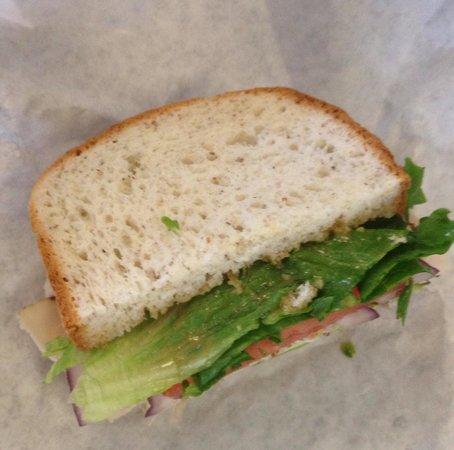Far Land Provisions: Udis bread, turkey, Brie, apples, cranberry chutney, lettuce tomato red onion