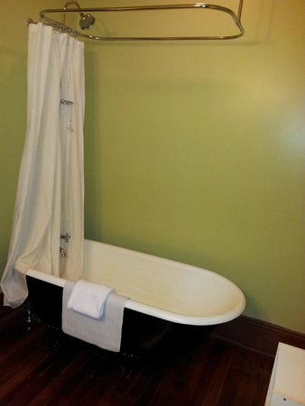 The Fitzpatrick Hotel : Claw foot bathtub with shower.