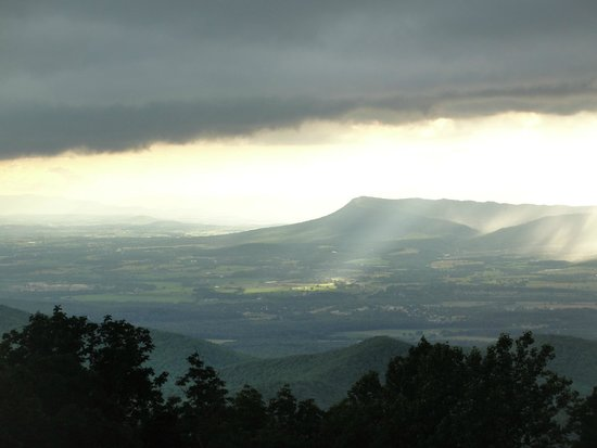 Lewis Mountain Cabins: Storm rolls across the valley as sun peaks through in spots