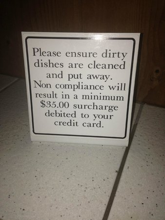 Desolation Resort: dirty dishes sign