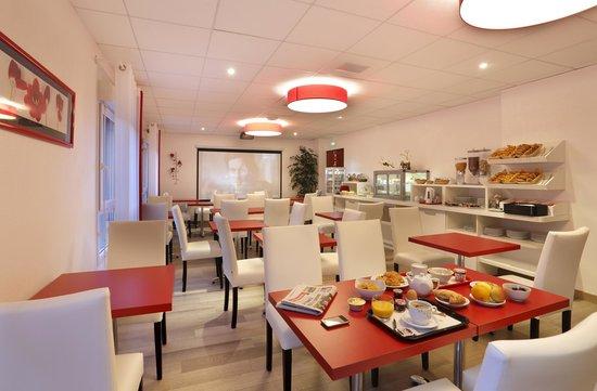 Inter Hotel Loval : LA SALLE DE PETIT DEJEUNER