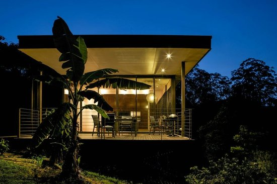 Glass on Glasshouse: Cottage deck and lounge at night