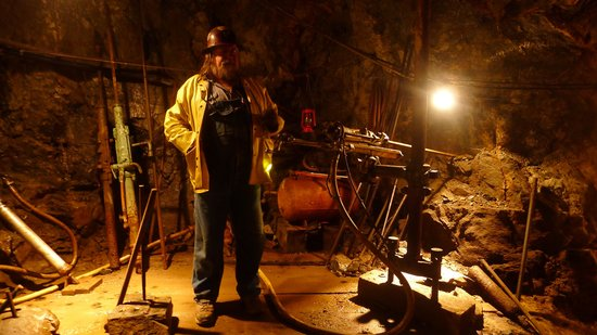 Old Hundred Gold Mine Tour: Your knowledgeable guide.