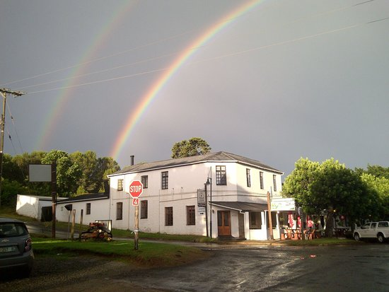 The Historic Pig & Whistle Inn: A summer storm and rainbow frame the old Inn