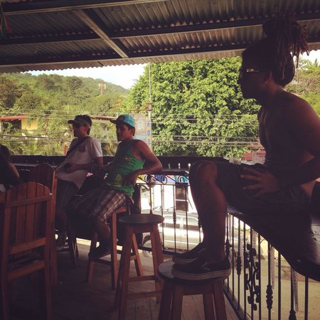Bar Arriba: Some locals watching the Colombia Brazil game and the awesome view in the background.