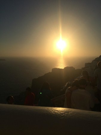 Art Maisons Luxury Santorini Hotels Aspaki & Oia Castle: View of the famous Oia sunset from our room. Champagne in hand.