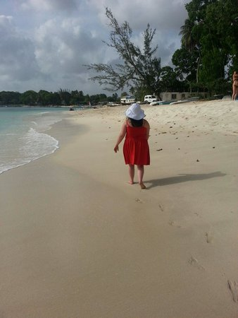 Mango Bay All Inclusive: June 2014..my daughter walking along beach outside mango bay