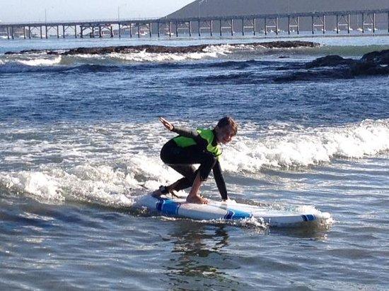 Van Curaza Surf School: Demonstrating her rail grab